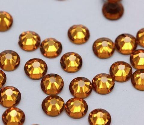 Стразы светло-золотые (пластик)