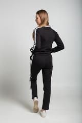 Спортивный костюм черного цвета с полосами оптом