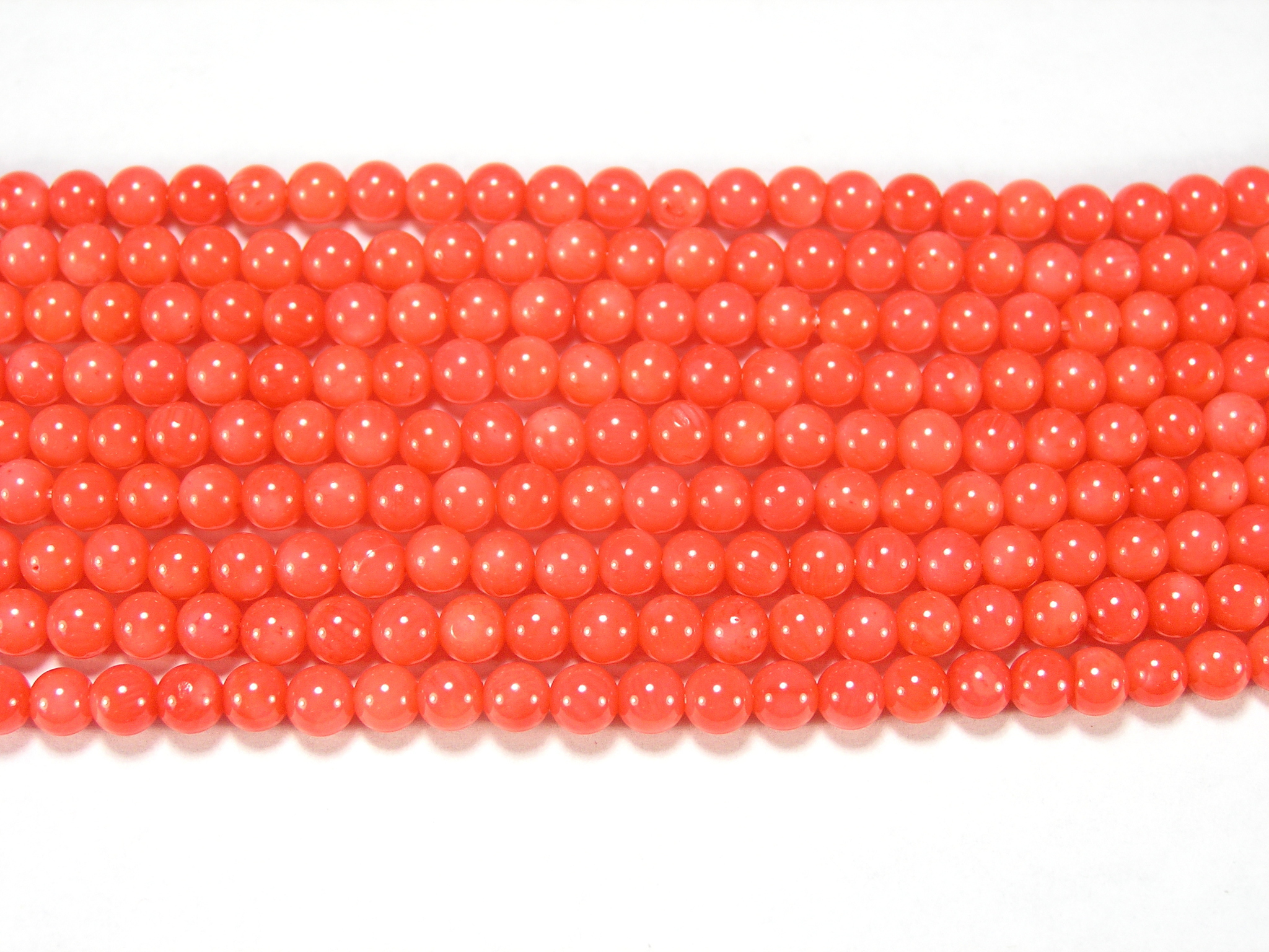 Нити бусин из коралла розового, шар гладкий 4мм (оптом)
