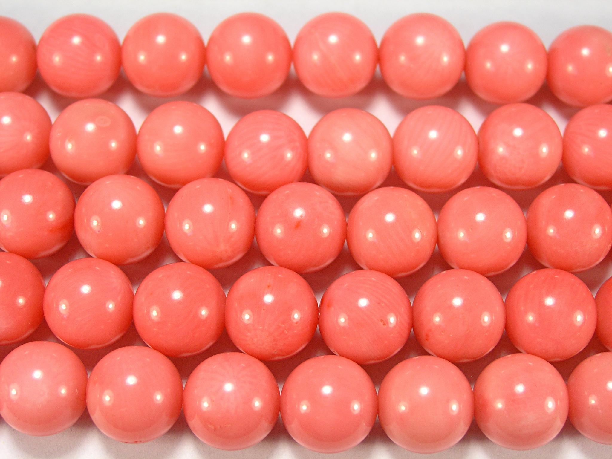 Нити бусин из коралла розового, шар гладкий 12мм (оптом)