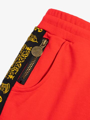 Спортивные штаны красного цвета с лампасами, без манжета