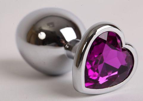 Серебристая анальная пробка с фиолетовым стразиком-сердечком - 8 см.