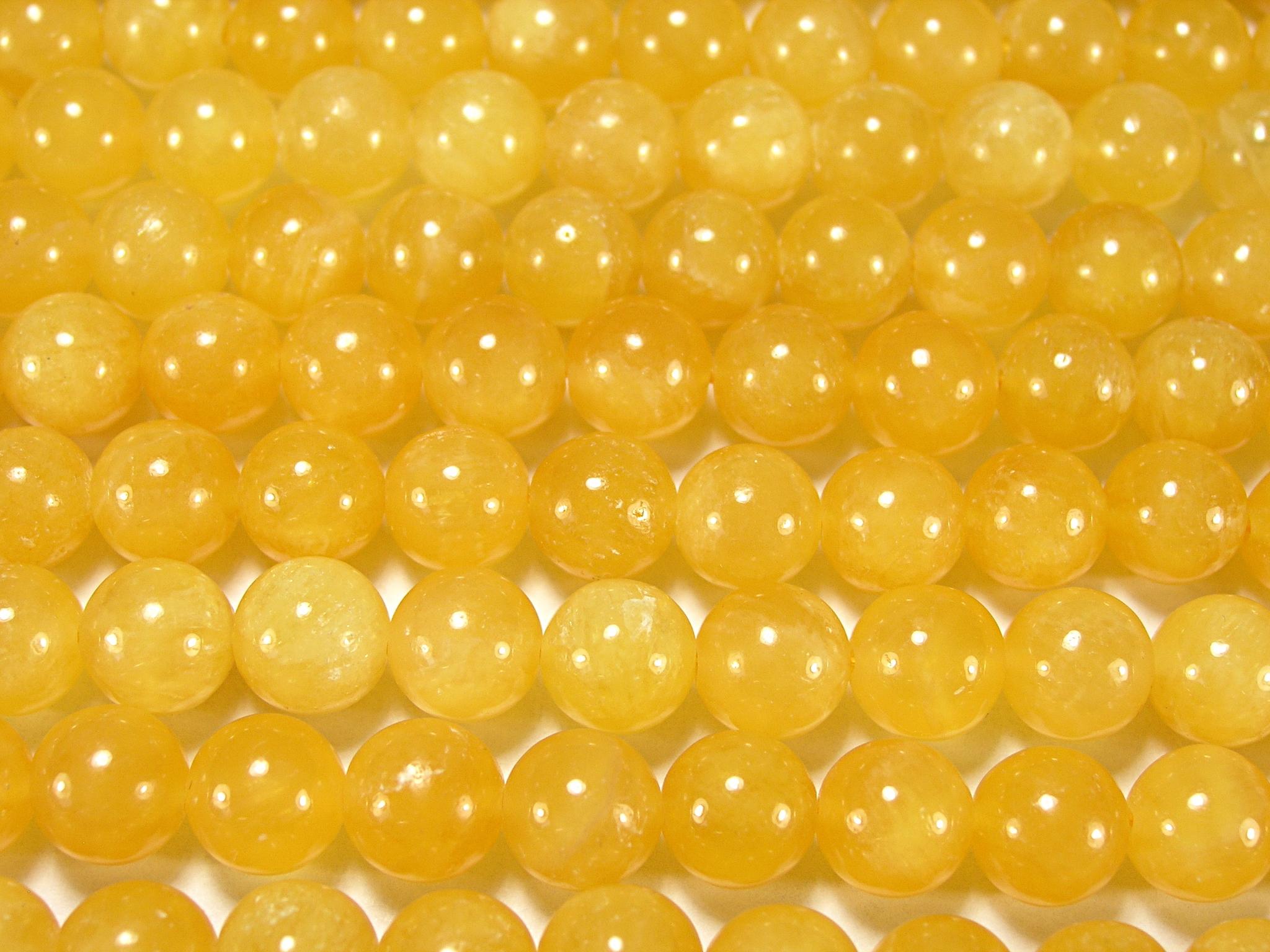 Нити бусин из кальцита желтого, шар гладкий 10мм (оптом)
