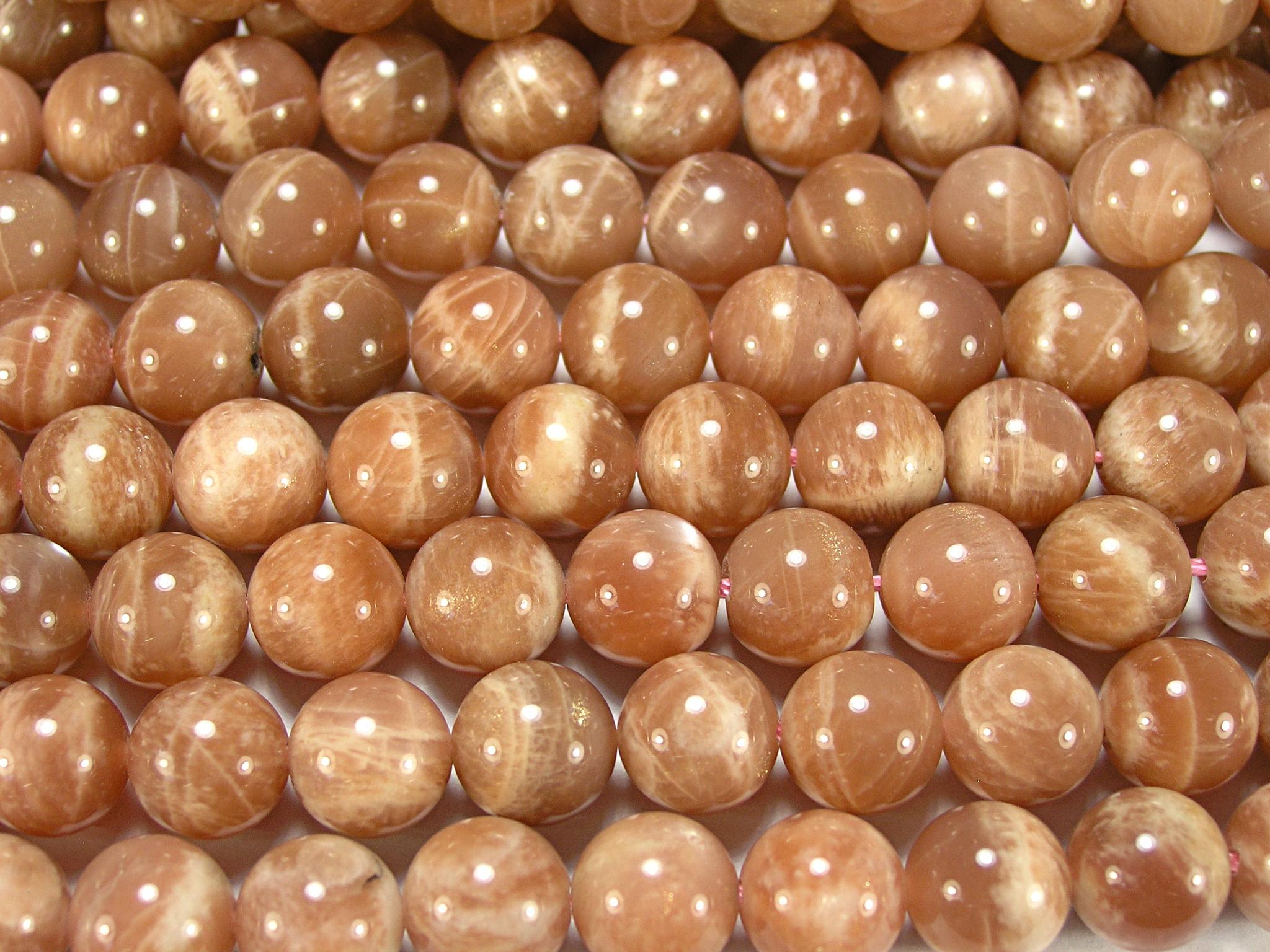 Нити бусин из солнечного камня, шар гладкий 10мм (оптом)