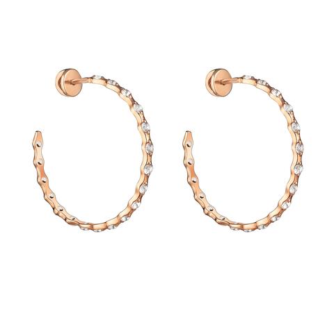 Серьги-кольца с белыми топазами в позолоте