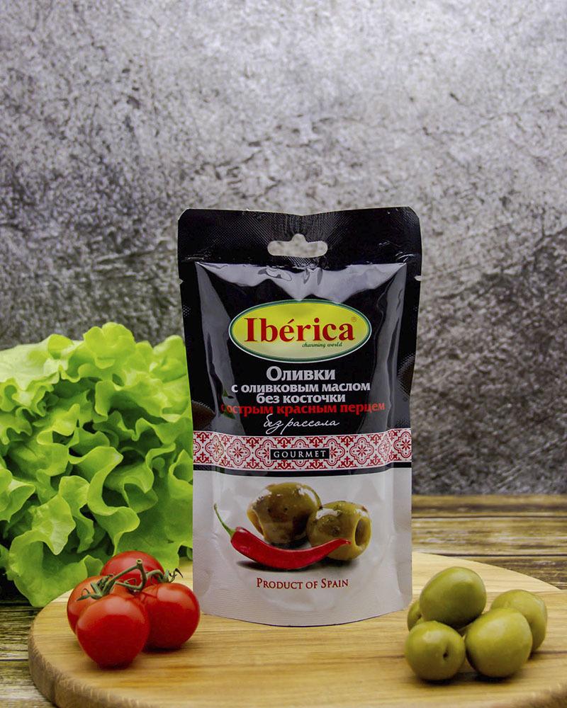 Оливки Iberica с оливковым маслом и острым красным перцем без косточки (без рассола) 70 гр.