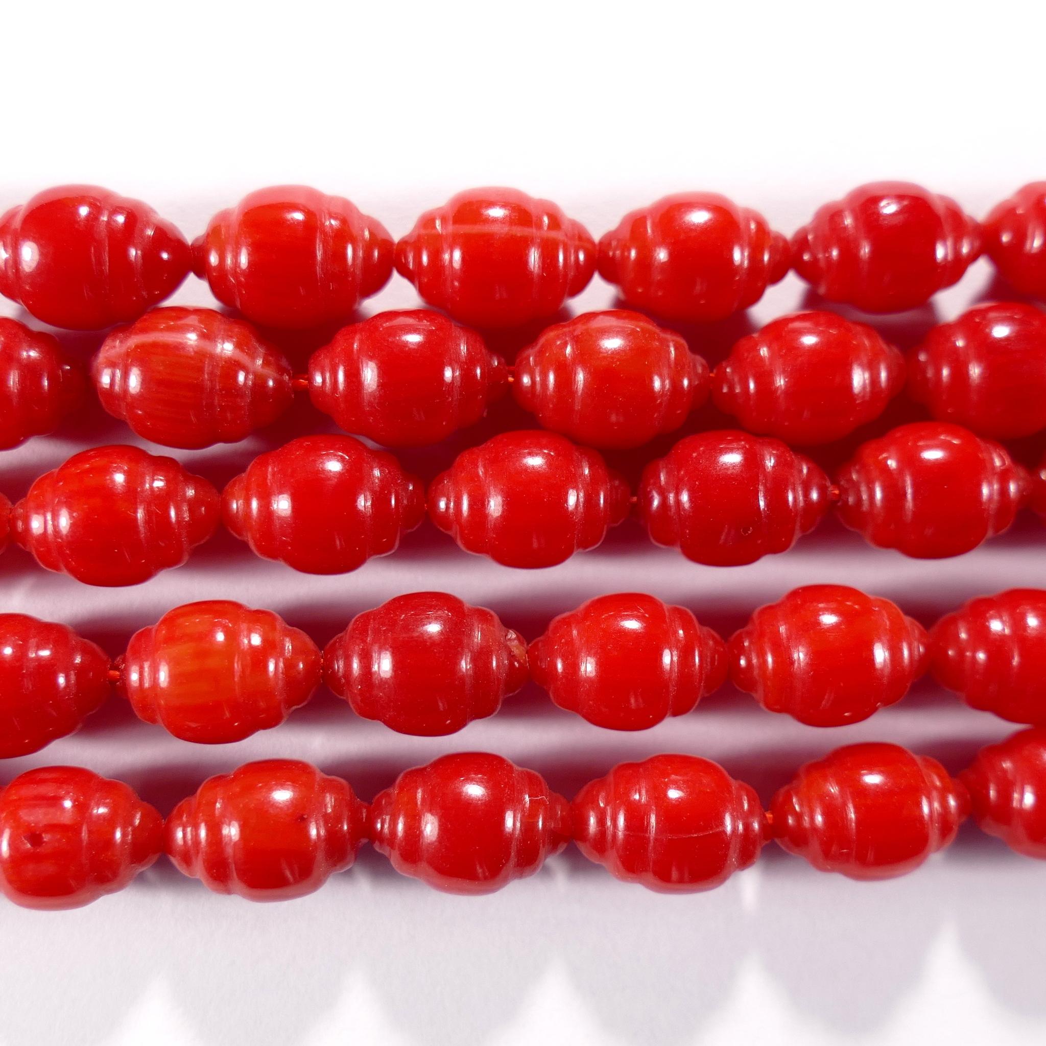 Нить бусин из коралла красного, облагороженного, фигурные, 6x9 мм (овал резной, гладкая)