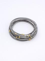 Браслет многослойный из пружинок с бусинами покрытыми желтым золотом  оптом и в розницу