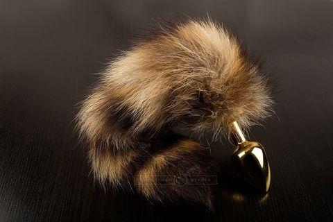Маленькая золотистая пробка с хвостом енота - 7,5 см.