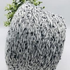 Фантазийная пряжа помпоны FIL FLY s.r.l  Marakesh Bonbon 200 черно-белое мулине