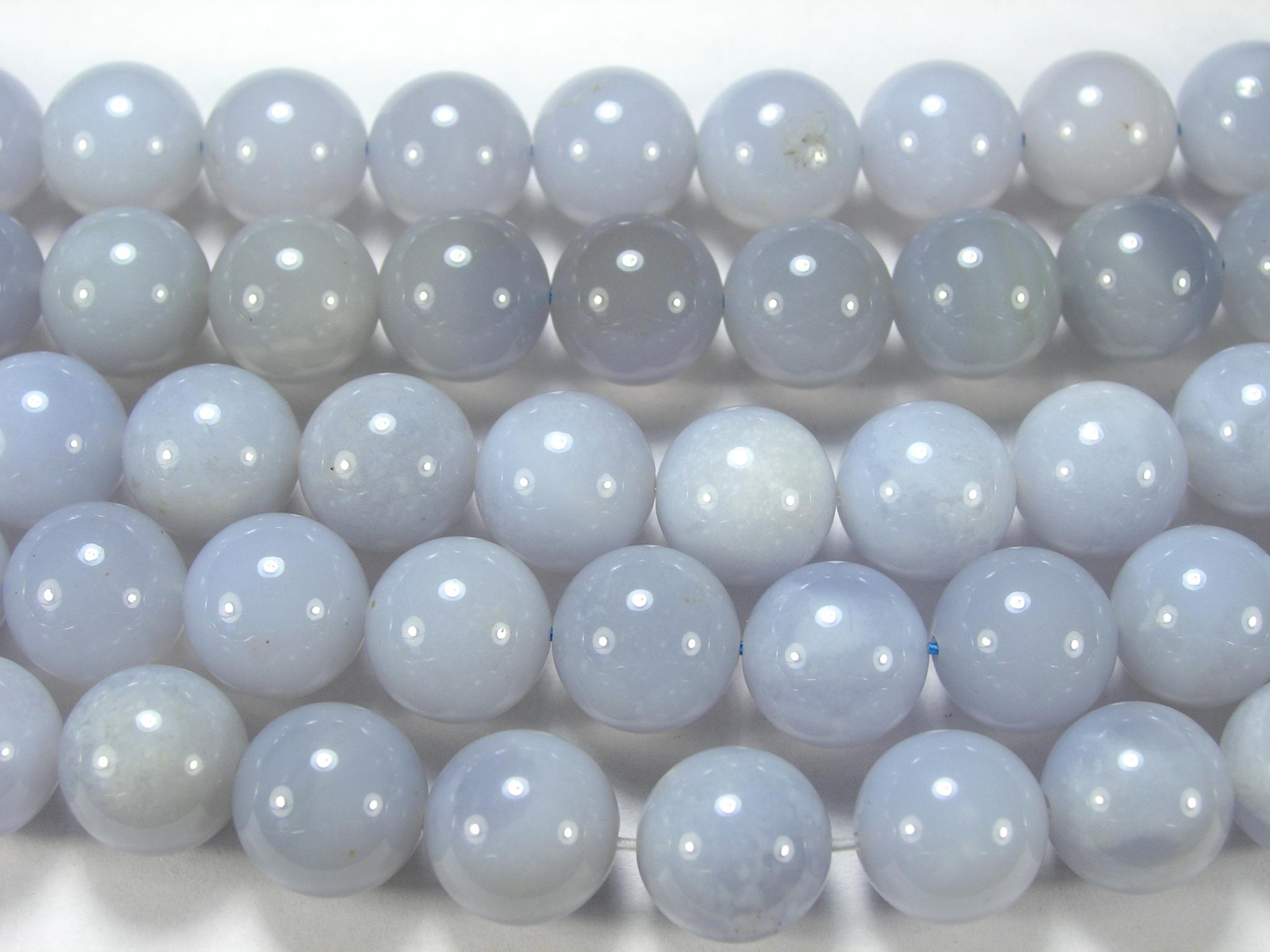 Нити бусин из халцедона голубого, шар гладкий 12мм (оптом)
