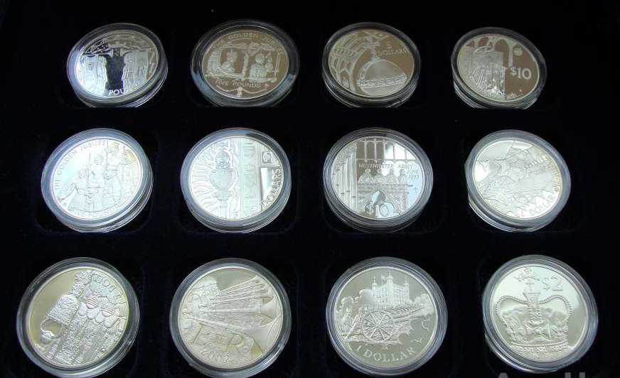Набор из 24 шт 1, 2, 5, 10 долларов, 5 фунтов 2002-2003гг. 50 лет правления Елизаветы II. Англия. Серебро