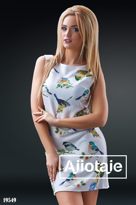 Льняное платье белого цвета с птичками