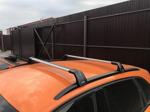 Багажник Inter AEROSTAR на Geely Atlas 2017-2019 R-75i серебристый на низкие рейлинги
