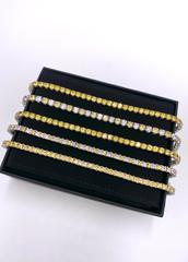 51940- Теннисный браслет дорожка из серебра с круглыми, бело-желтыми цирконами бриллиантовой огранки