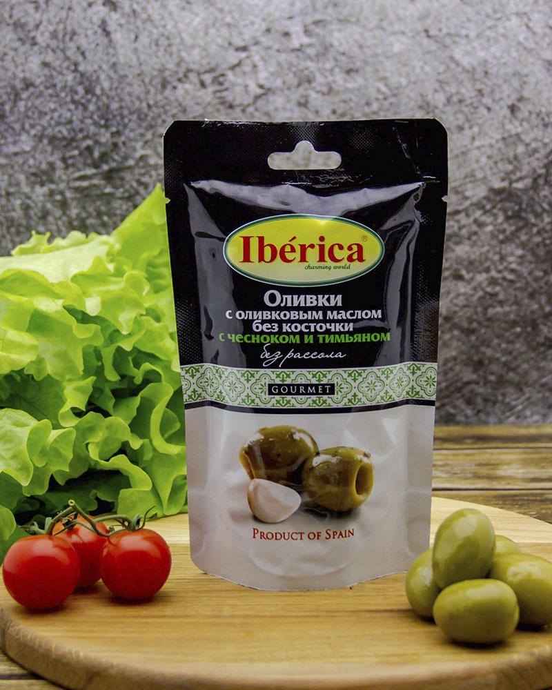 Оливки Iberica с оливковым маслом, чесноком и тимьяном без косточки (без рассола) 70 гр.