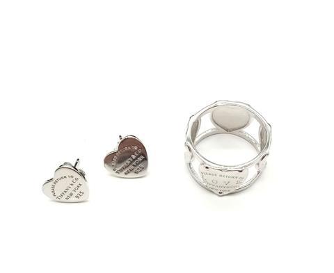 Широкое кольцо из серебра с сердечками на шинке