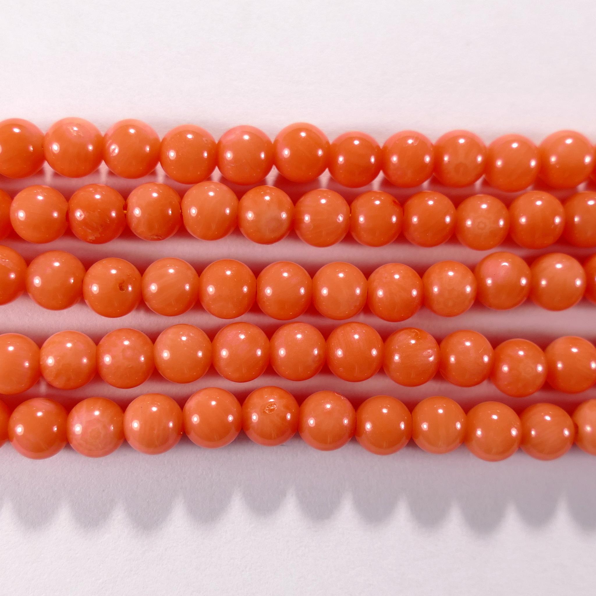 Нить бусин из коралла оранжевого, облагороженного, шар гладкий 4мм