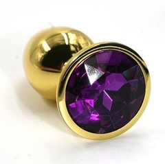 Золотистая анальная пробка с темно-фиолетовым кристаллом