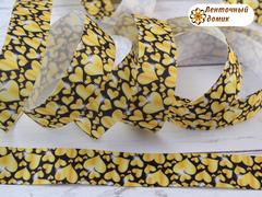 Лента репсовая желтые сердечки на черном 25 мм