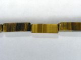 Бусина из тигрового глаза, фигурная, 4x13 мм (цилиндр, граненая)