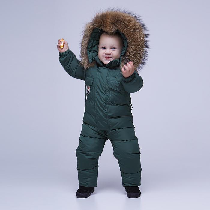 Дитячий однотонний зимовий комбінезон темно-зеленого кольору і опушкою з натурального хутра