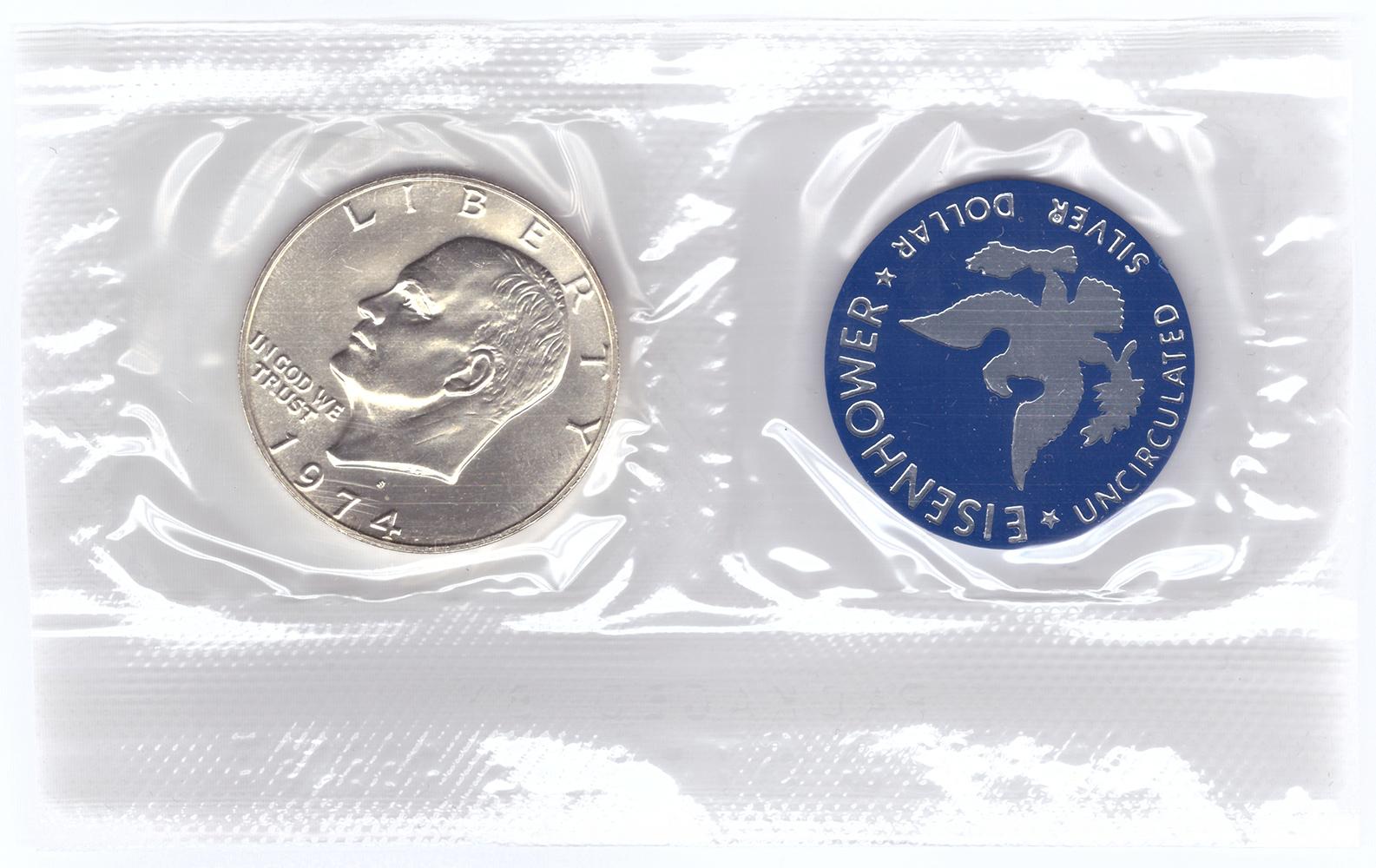 1 доллар 1974 (S) США Эйзенхауэр (лунный) с жетоном UNC (в родном конверте)