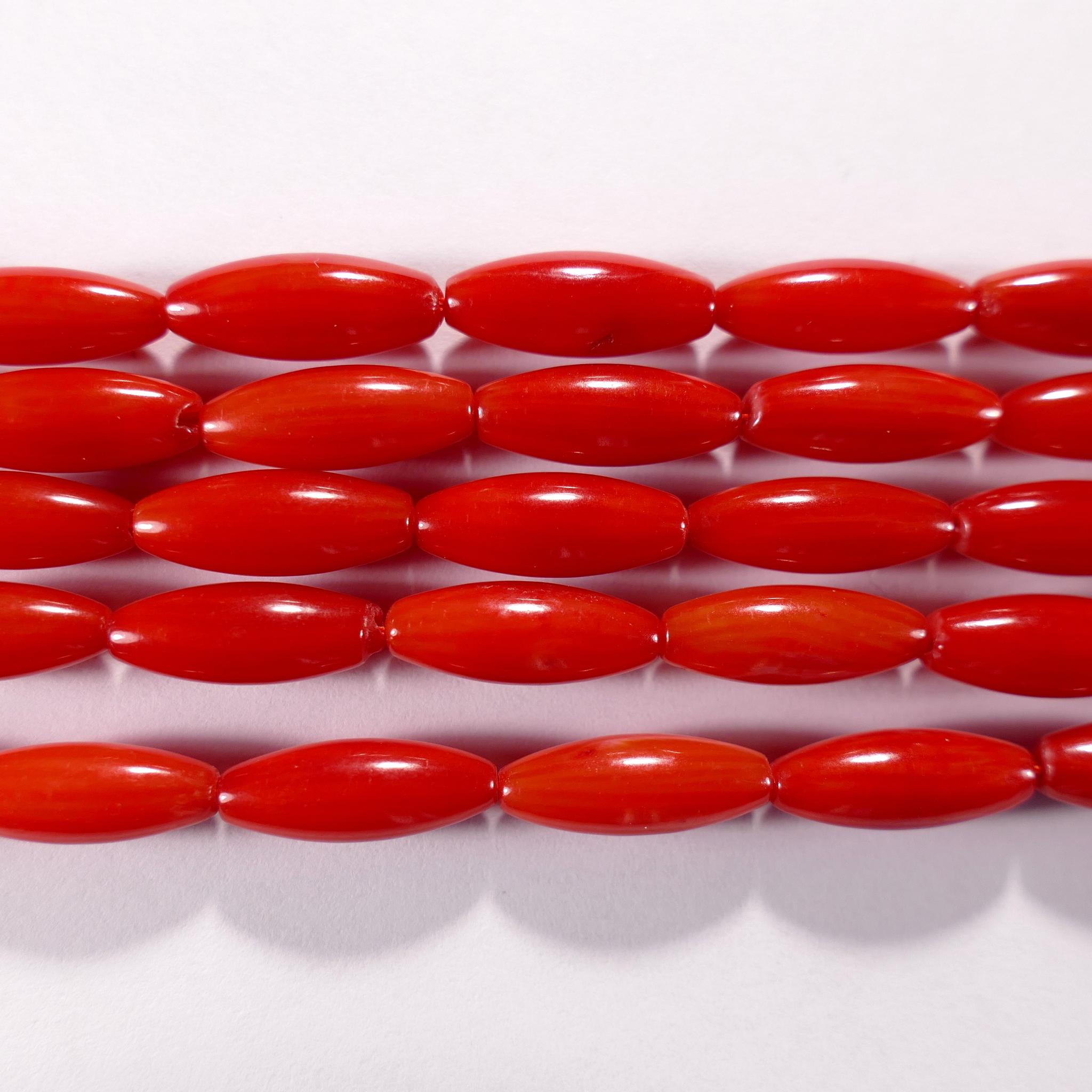 Нить бусин из коралла красного, облагороженного, фигурные, 5x14 мм (овал, гладкая)