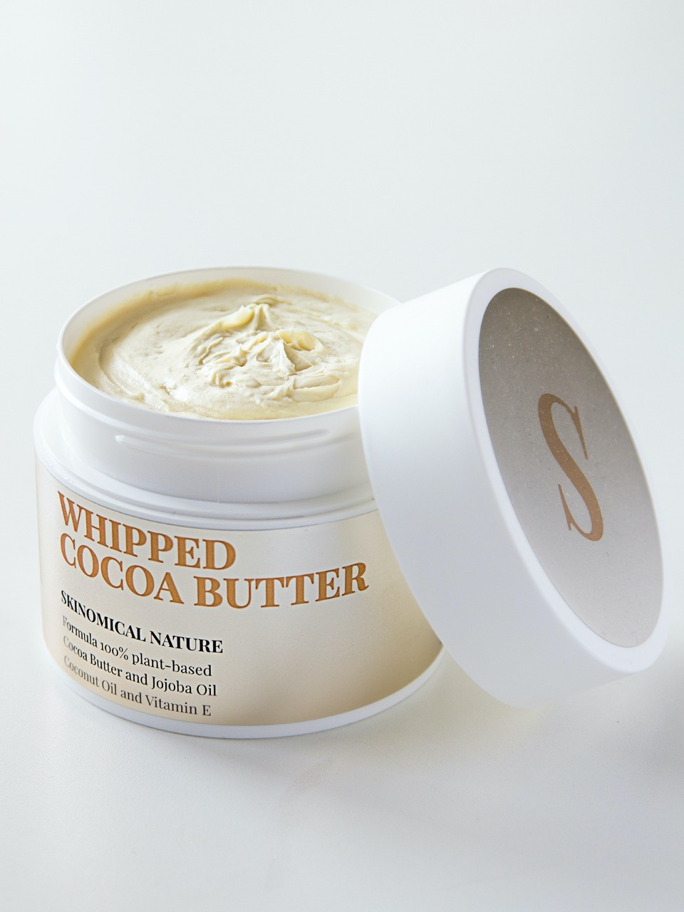 Лосьоны для тела Взбитое масло Какао Whipped Cocoa Butter, 200 мл uploads_photos__SKINOMICAL__790218-_SKINOMICAL___Взбитое_масло_Какао_Whipped_Cocoa_Butter__200_м.jpg