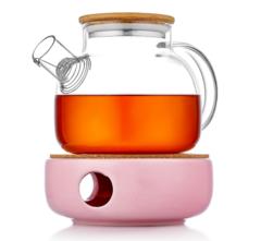 Заварочный чайник на розовой керамической подставке с подогревом от свечой