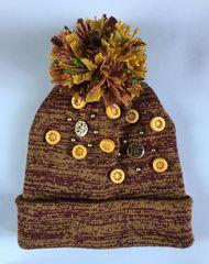 Оригинальная женская шапочка с пумпоном