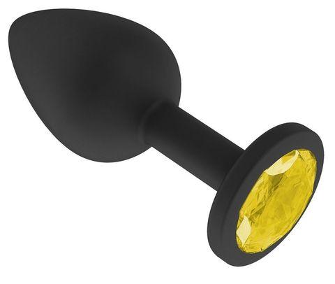 Чёрная анальная втулка с жёлтым кристаллом - 7,3 см.