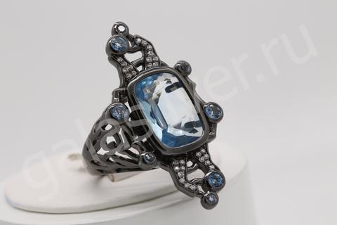 Кольцо с топазом и цирконами из серебра 925