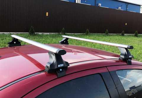 Багажник Inter на Ssang Yong Kyron 2005-2014 за дверной проем аэродинамические  дуги 120 см.