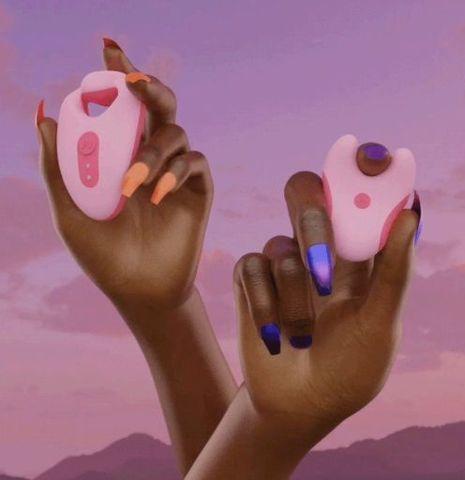 Розовый портативный клиторальный вибратор Divvy