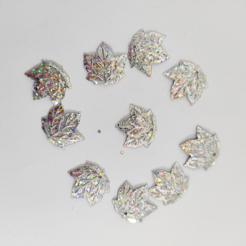 Пайетки лист кленовый серебро голограф 50грамм 22*20мм