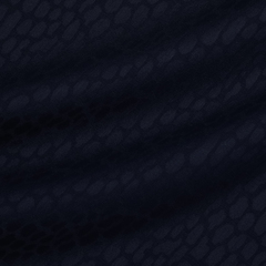 Костюмная ткань из шерсти с эластаном с леопардовыми пятнами в тёмно-синем цвете