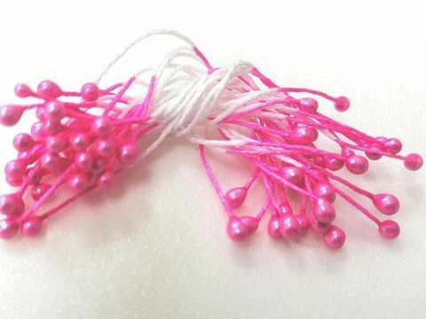Тычинки 35 нитей, двусторонние , цвет  розовый.