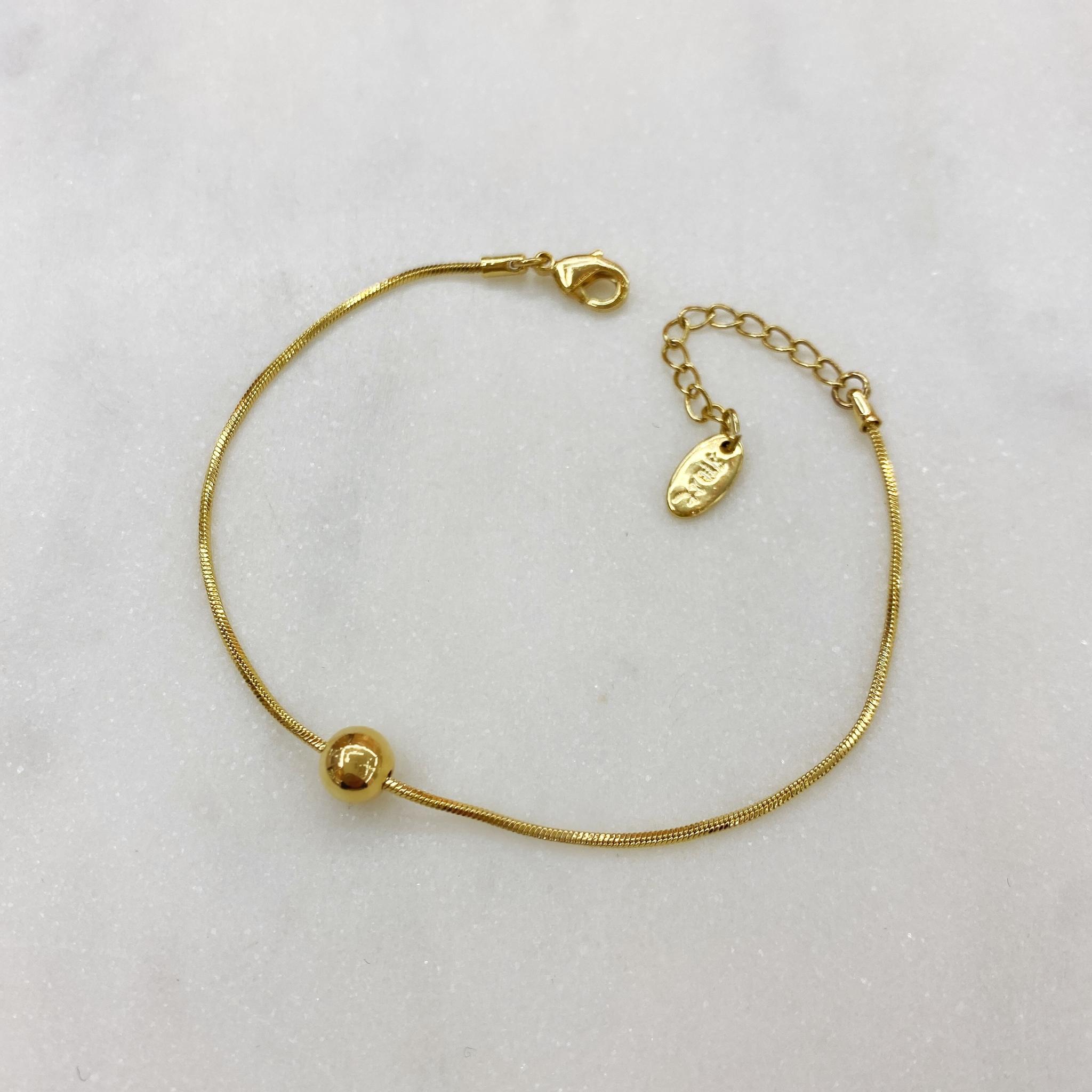 Браслет-цепочка с шармом бусинка золотой
