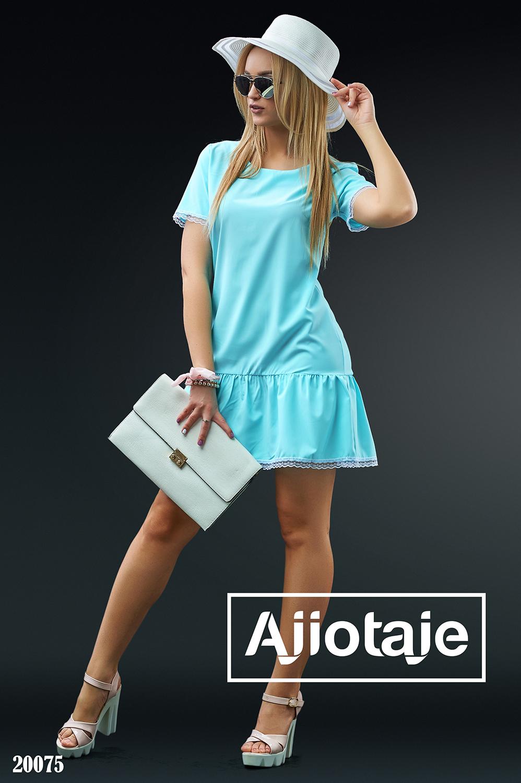 Платье голубого цвета в стиле «торсо»