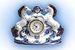 Часы Кони