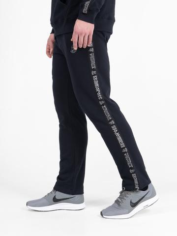 Спортивные штаны тёмно-синего цвета с лампасами, без манжета