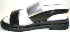 Черные кожаные босоножки на низком ходу Marani Magli