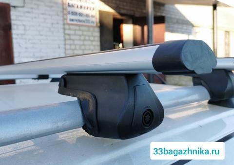 Багажник Дельта Партнер на рейлинги с аэродинамической  поперечиной 120 см.
