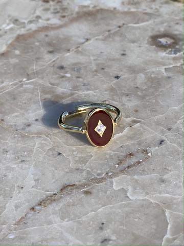 Кольцо Аврора из позолоченного серебра с бордовой эмалью