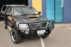 Бампер силовой Delux Black Commercial Toyota Hilux c 10/2011