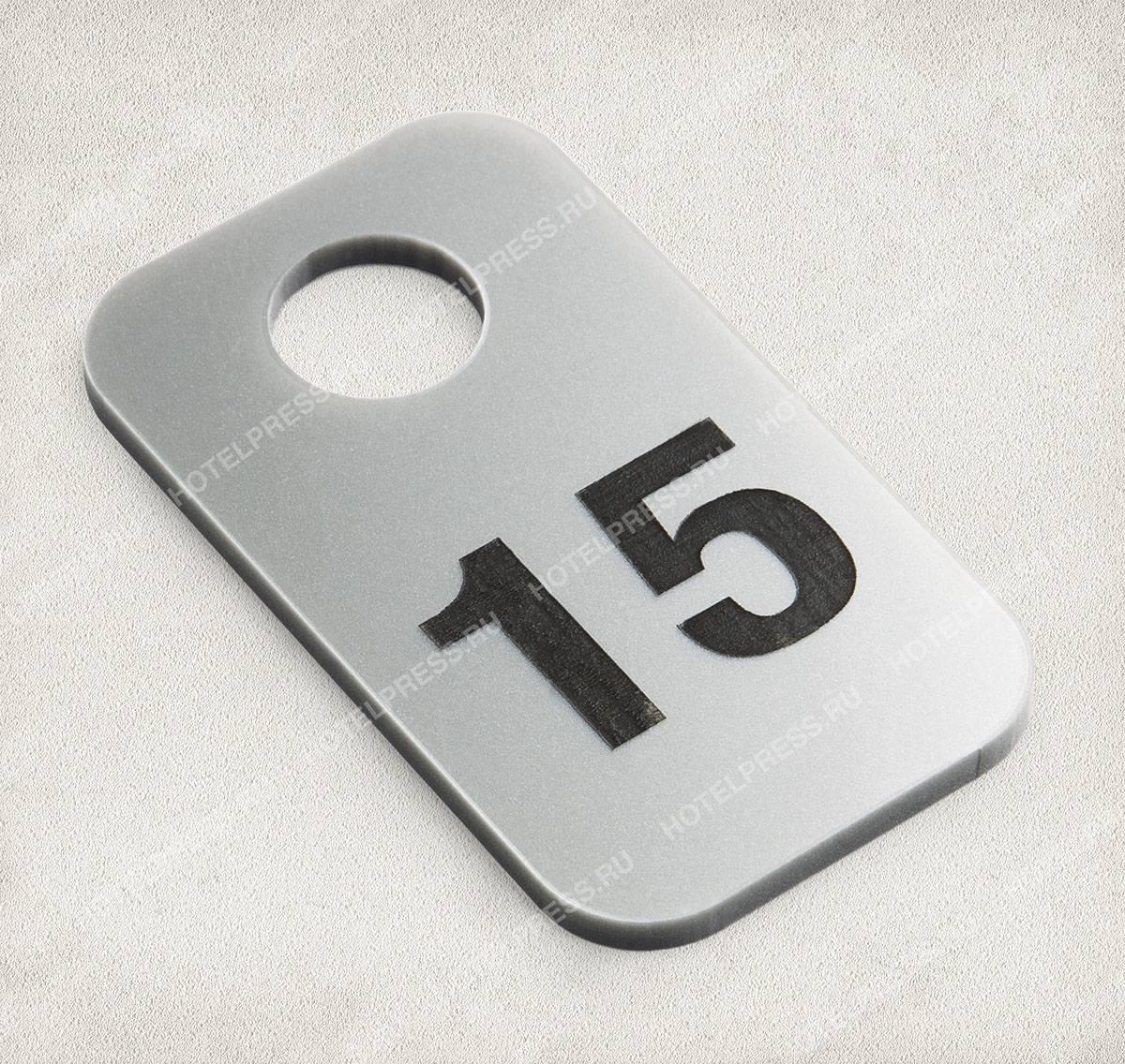 Номерок и бирка из двухслойного пластика с лазерной гравировкой