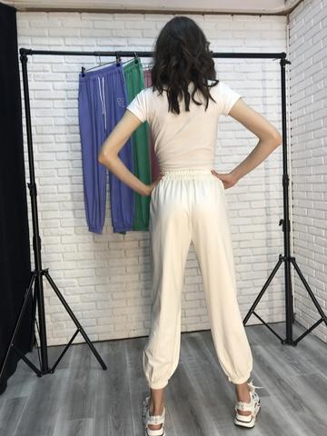 Спортивные штаны из белого трикотажа купить