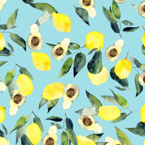 Лимоны и авокадо на голубом фоне