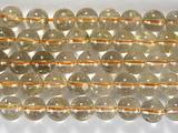 Нить бусин из кварца рутилового золотого, шар гладкий 7 мм